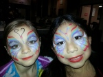Rainbow Butterfly face paints painted by Cynnamon at the Upland Rotary Club event at Harvey Mudd College in Claremont