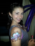 She loves Justin Bieber and was so happy with her arm painting that I painted in the Kid zone.