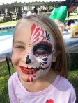 Half sugar skull face paint by Cynnamon in Corona